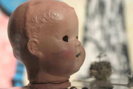 image of hollow toy baby head